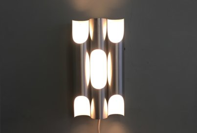 Raak 'Fugue' wall light designed by Maija Liisa Komulainen, Netherlands c1970. Brushed aluminium with white enamel.