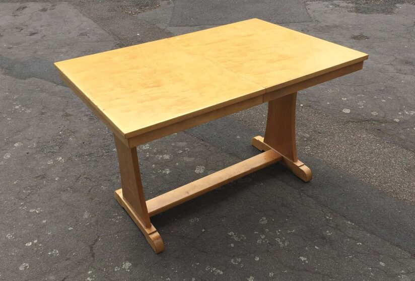 A 1930's Art Deco satin birch dining table with an extra leaf